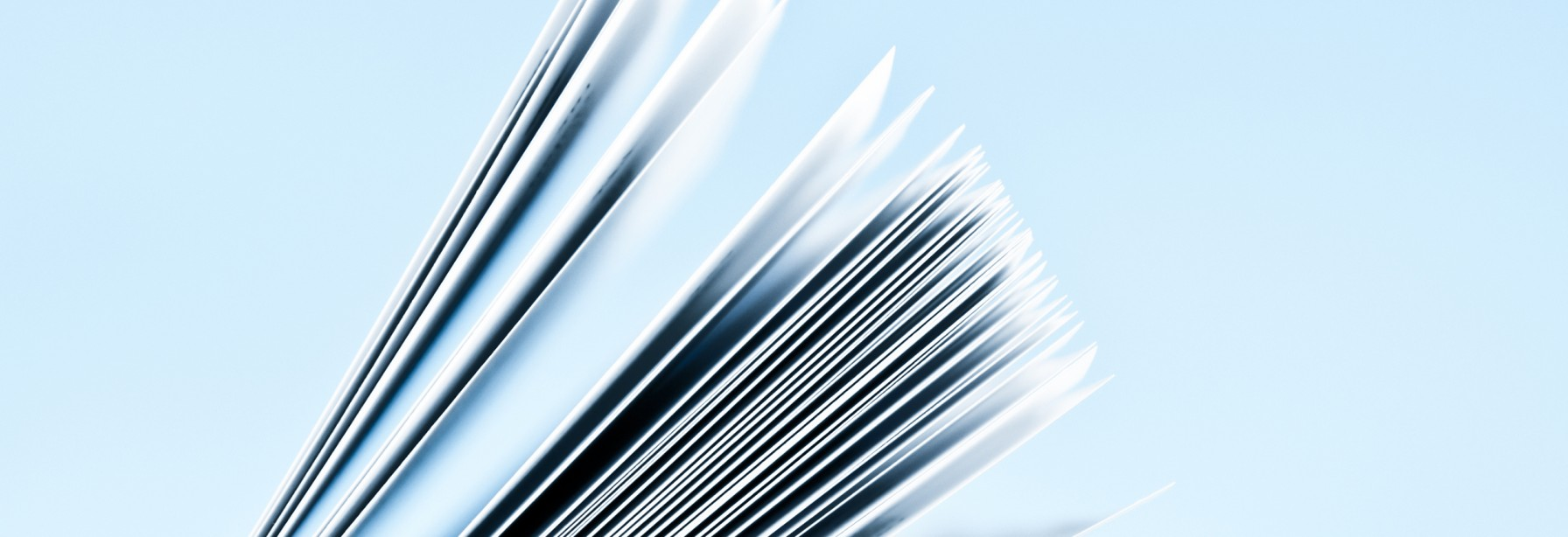 Stack of papers on a blue background
